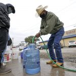 Texas power outages below half a million, water crisis persists