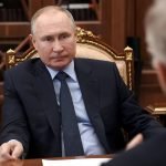 Russian President Vladimir Putin signs law allowing him to potentially stay in power until 2036